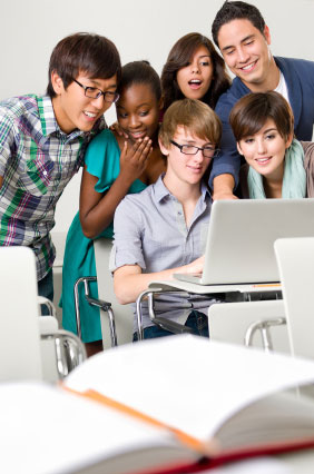 A group of students looking at something on a computer